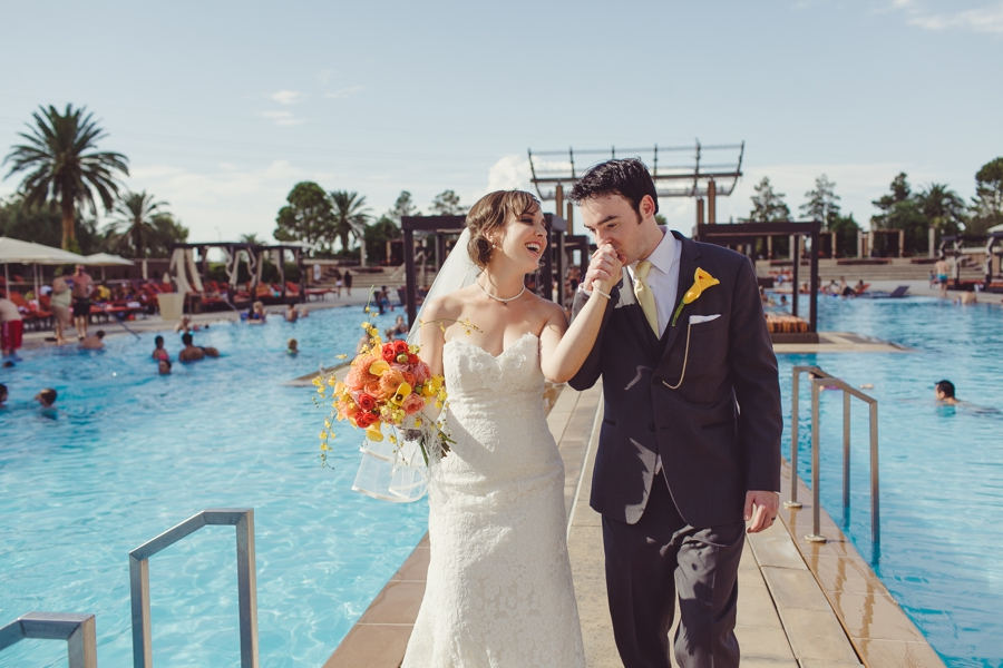 M Resort Las Vegas Wedding Photographer, M Resort Pool Wedding Pictures, Bride Pictures with Orange, Yellow and Pink Bridal Flower Bouquet.  Couture Bride Wedding Dress Las Vegas
