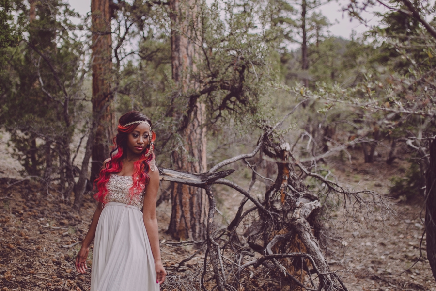 Grecian style portrait photography with Bohemian influences.  Mount Charleston Las Vegas photo ideas.  Red hair highlights and white bohemian dress.